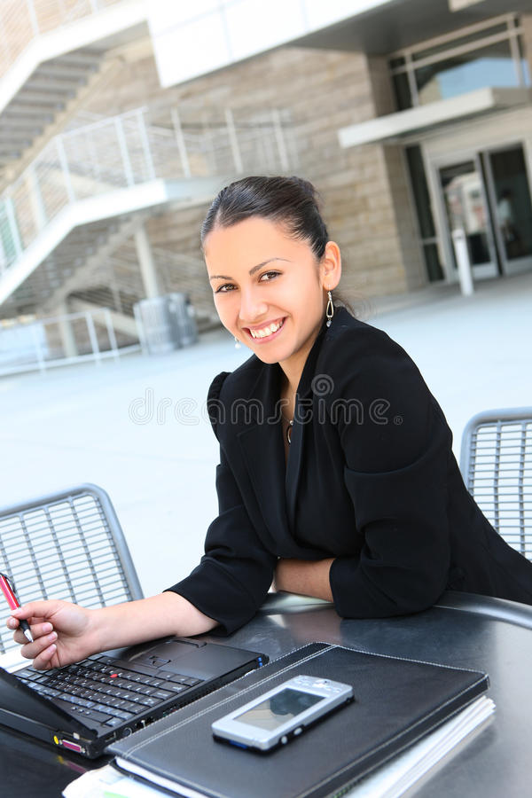 Mulher de negócio feliz na companhia fotografia de stock royalty free