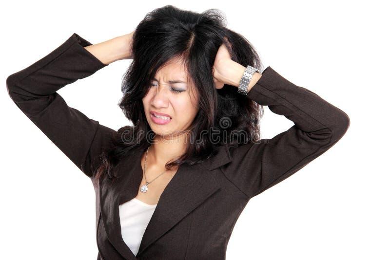 Mulher de negócio forçada no trabalho imagens de stock