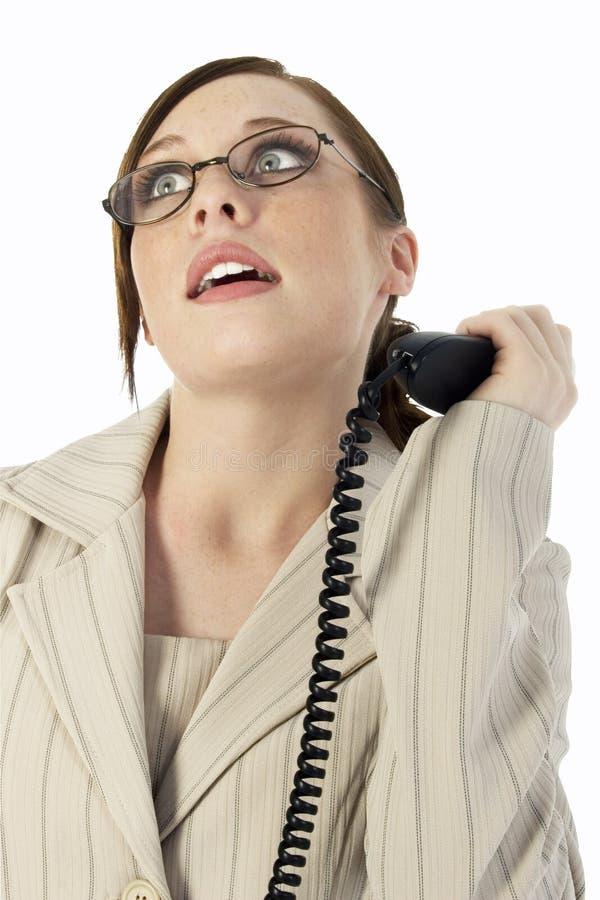 Mulher de negócio frustrada com atendimento de telefone imagens de stock royalty free