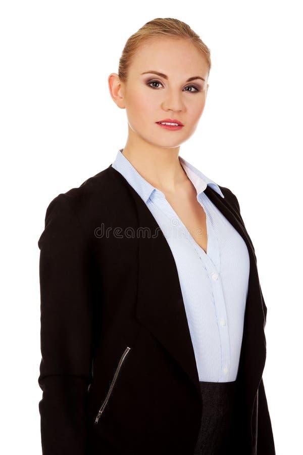 Mulher de negócio loura séria nova fotografia de stock royalty free