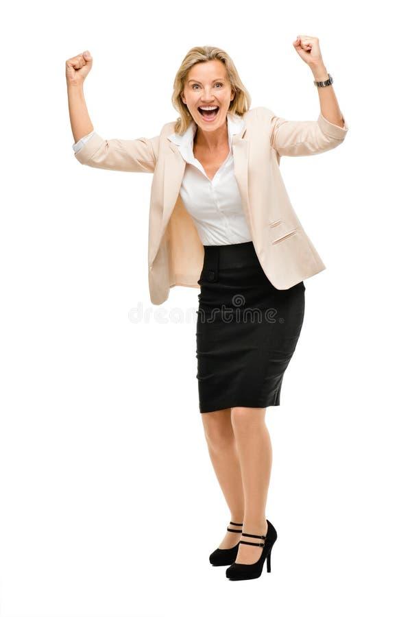 A mulher de negócio maduro que comemora o comprimento completo do sucesso isolou o fotos de stock