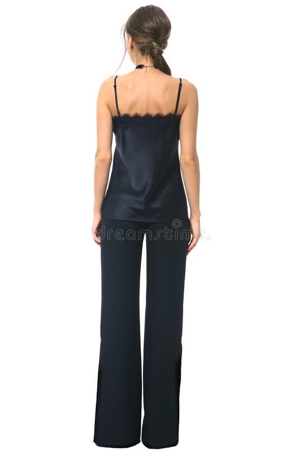 Mulher de negócio na camiseta de alças preta formal e na calças alargada da parte inferior de sino imagem de stock royalty free