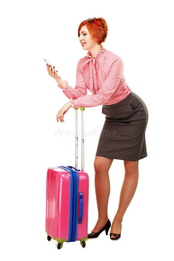 Mulher de negócio na viagem de negócios isolada no fundo branco fotografia de stock royalty free