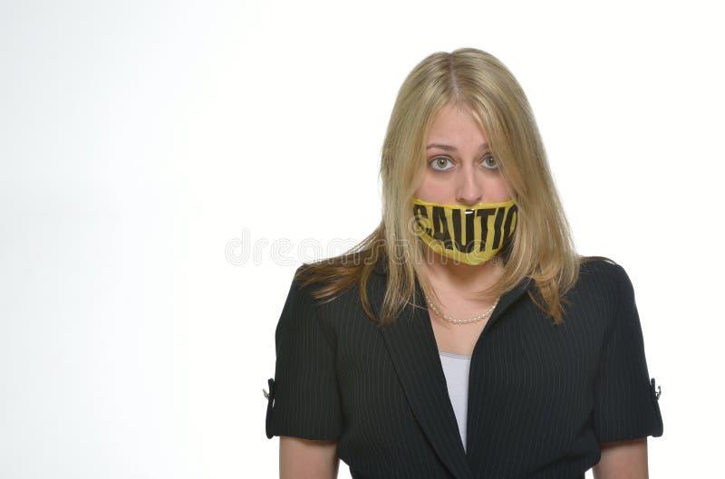 Mulher de negócio no estúdio - advirta a fita sobre a boca fotografia de stock royalty free