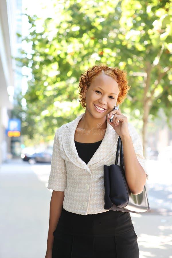 Mulher de negócio no telefone imagem de stock
