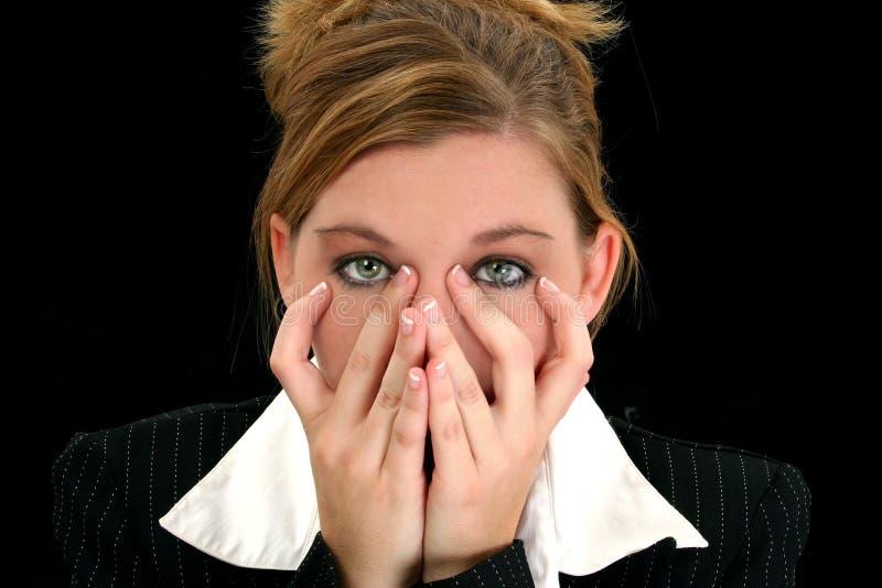 Mulher de negócio nova bonita com mãos na face fotos de stock royalty free