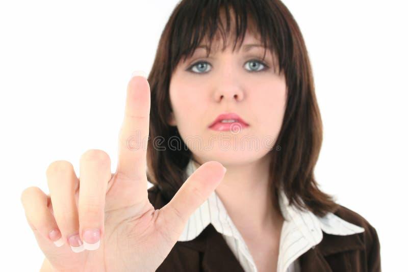 Mulher de negócio nova com dedo da terra arrendada acima fotos de stock royalty free