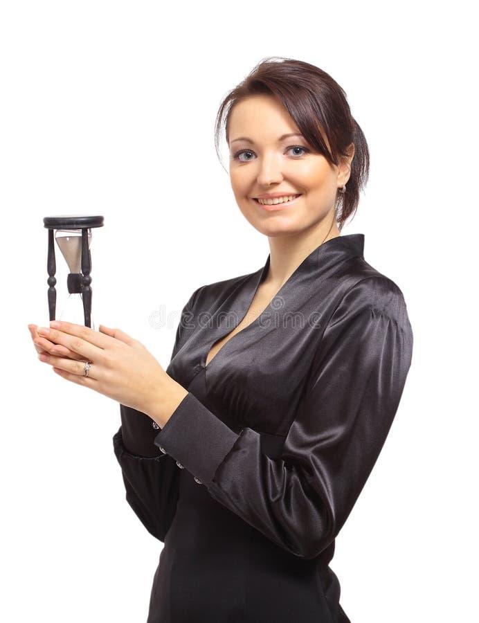 Mulher de negócio nova com hourglass foto de stock