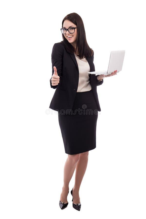 Mulher de negócio nova com os polegares do portátil isolados acima no branco fotos de stock