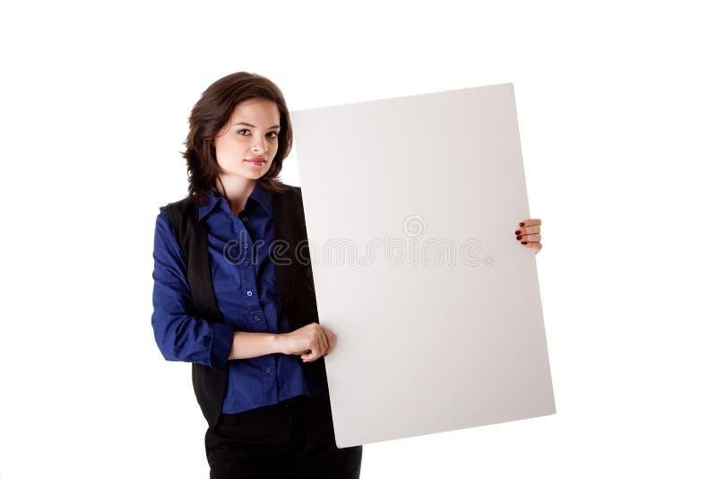 Mulher de negócio nova com placa branca imagem de stock royalty free