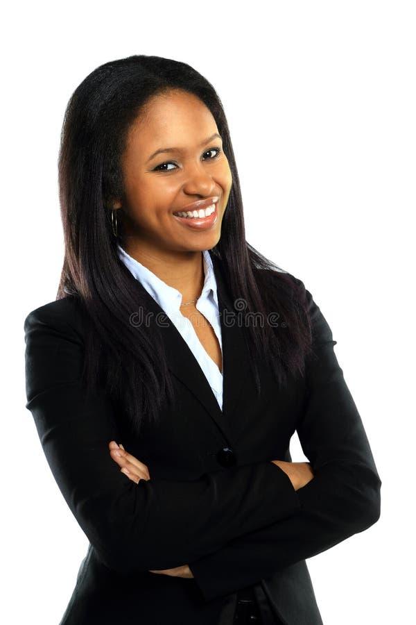Mulher de negócio nova com sorriso dobrado mãos fotografia de stock royalty free