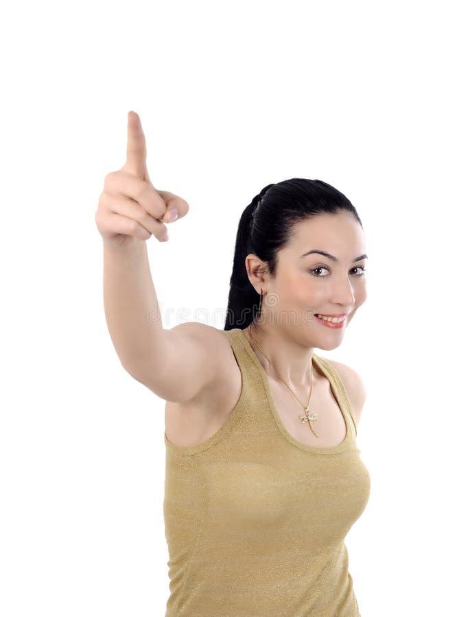 Mulher de negócio nova feliz que aponta para cima fotografia de stock royalty free