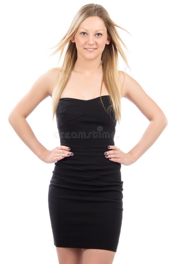 Mulher de negócio nova no sorriso preto do vestido foto de stock