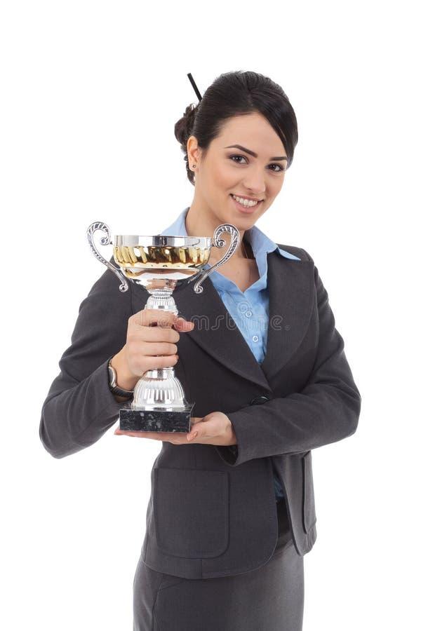 Mulher de negócio nova que ganha um troféu imagens de stock
