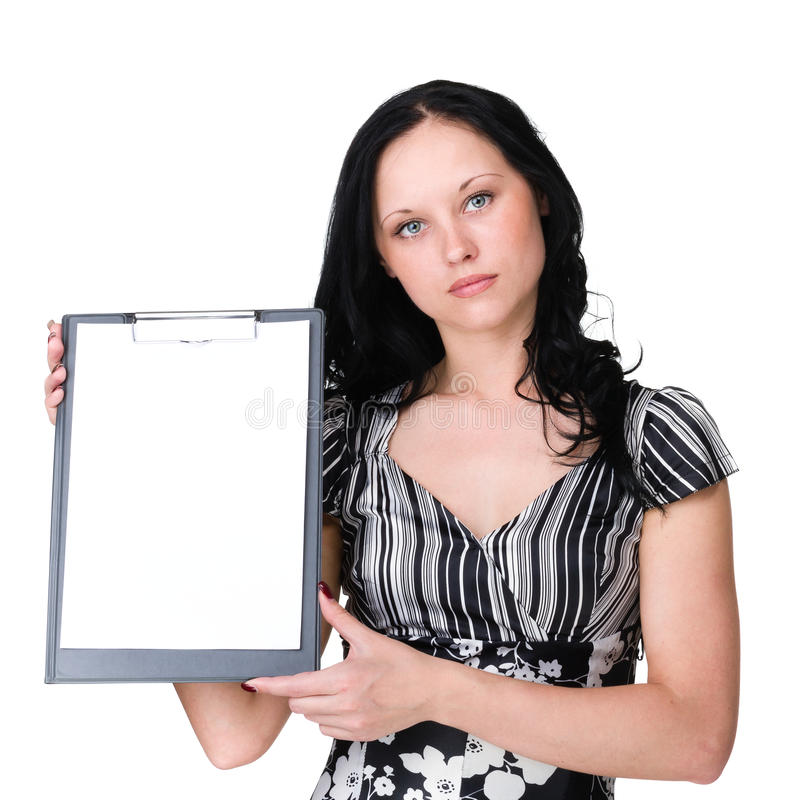 Mulher de negócio nova que mostra o quadro indicador vazio sobre o branco imagem de stock
