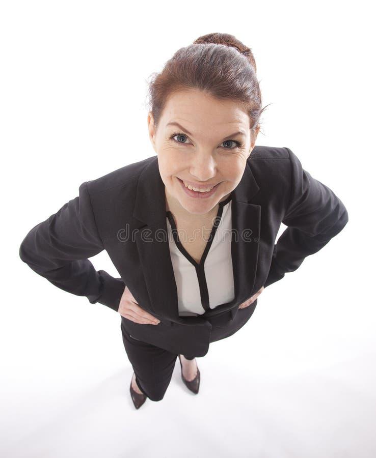 Mulher de negócio nova que olha acima de cima do isolado fotografia de stock