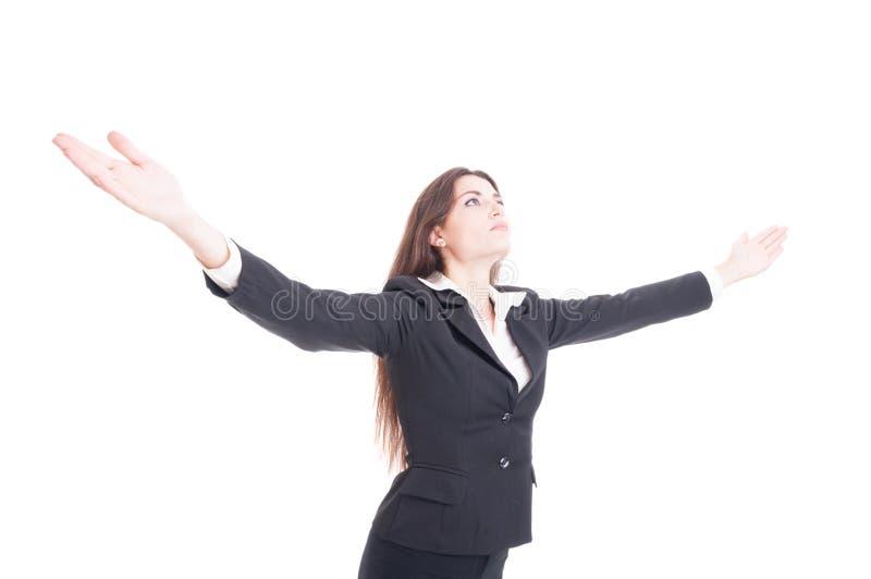 Mulher de negócio nova 'sexy' que guarda a propagação larga dos braços que expressa a SU fotos de stock