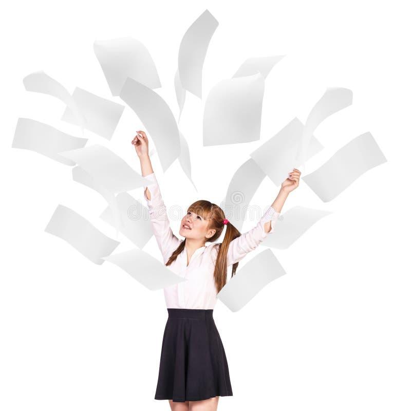 Mulher de negócio nova sob páginas de queda imagem de stock