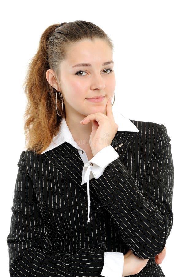 Mulher de negócio positiva que sorri sobre fotos de stock
