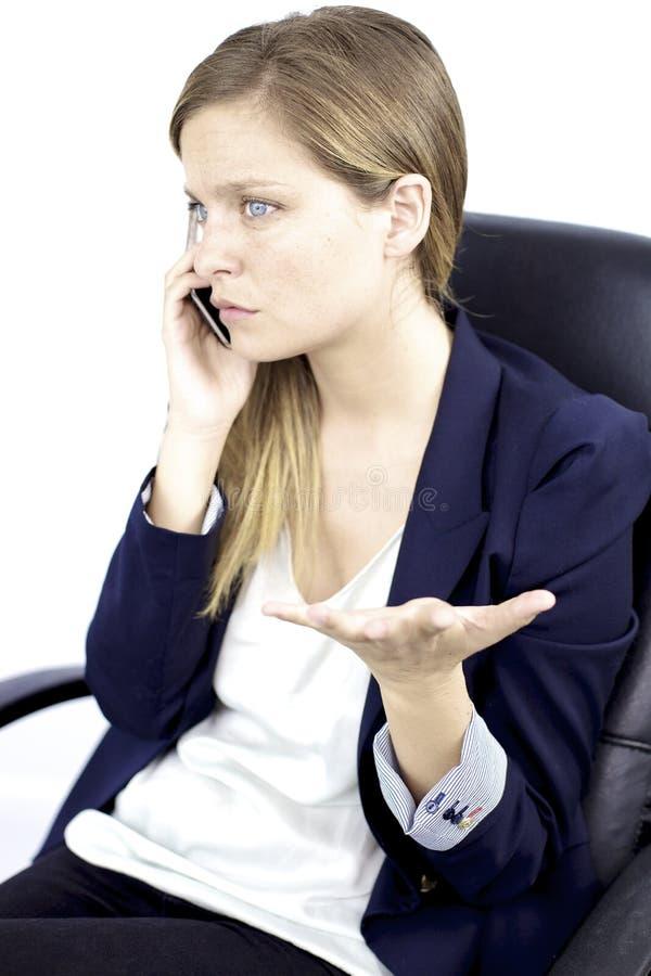 Mulher de negócio preocupada no telefone imagem de stock
