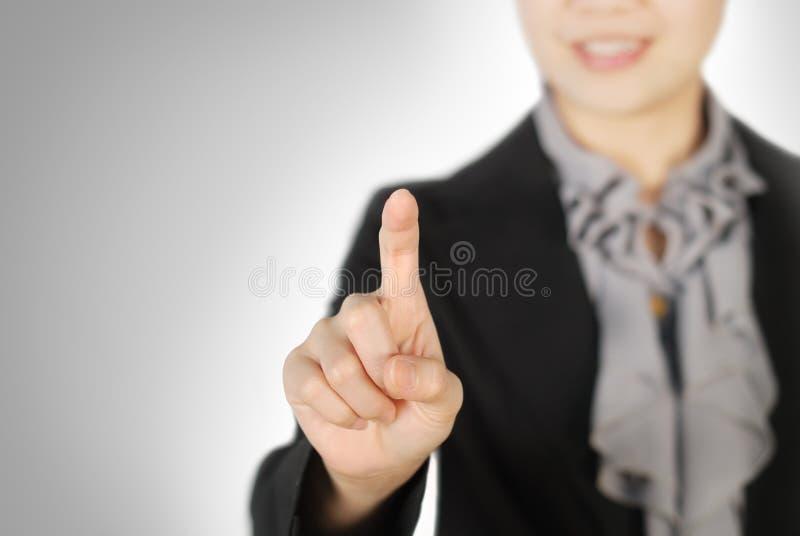 Mulher de negócio que aponta algo fotografia de stock