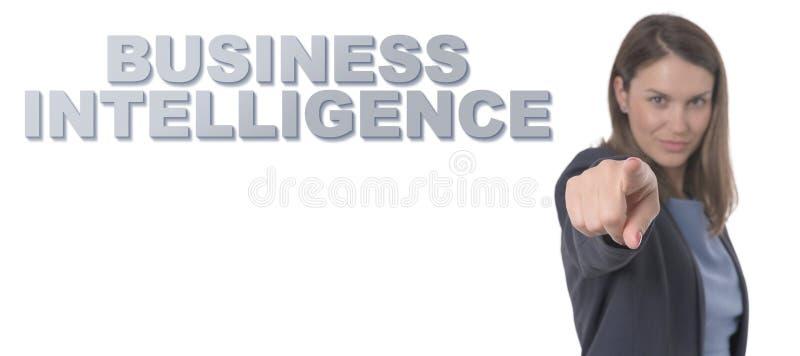 Mulher de negócio que aponta a INTELIGÊNCIA EMPRESARIAL do texto fotos de stock royalty free