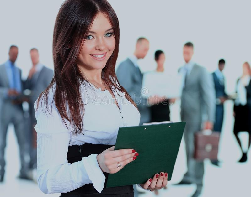 Mulher de negócio que conduz sua equipe isolada sobre um fundo branco imagens de stock