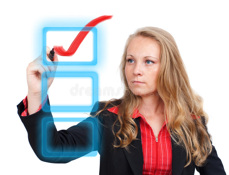 Mulher de negócio que desenha uma marca de verificação vermelha virtual imagem de stock royalty free