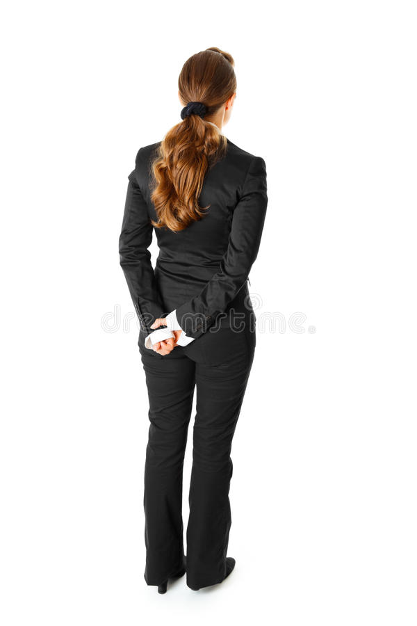 Mulher de negócio que está com ela de volta à câmera fotos de stock royalty free