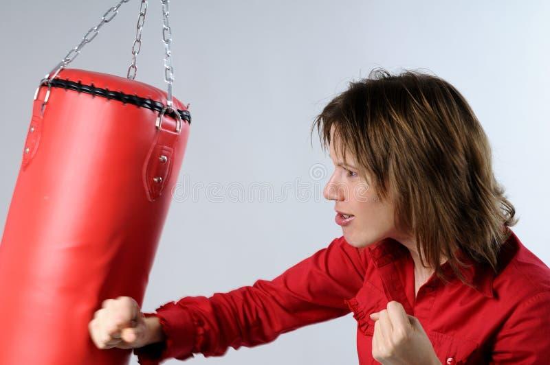 Mulher de negócio que expressa a gerência da raiva foto de stock