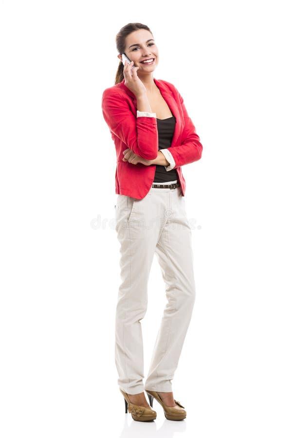 Mulher de negócio que fala no telefone imagem de stock royalty free