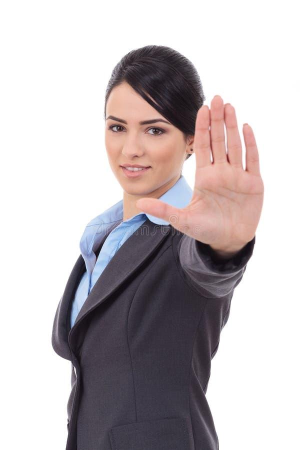 Mulher de negócio que faz o sinal da parada imagem de stock