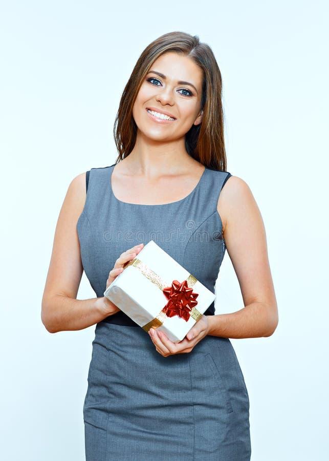 Mulher de negócio que guarda a caixa de presente pequena imagem de stock