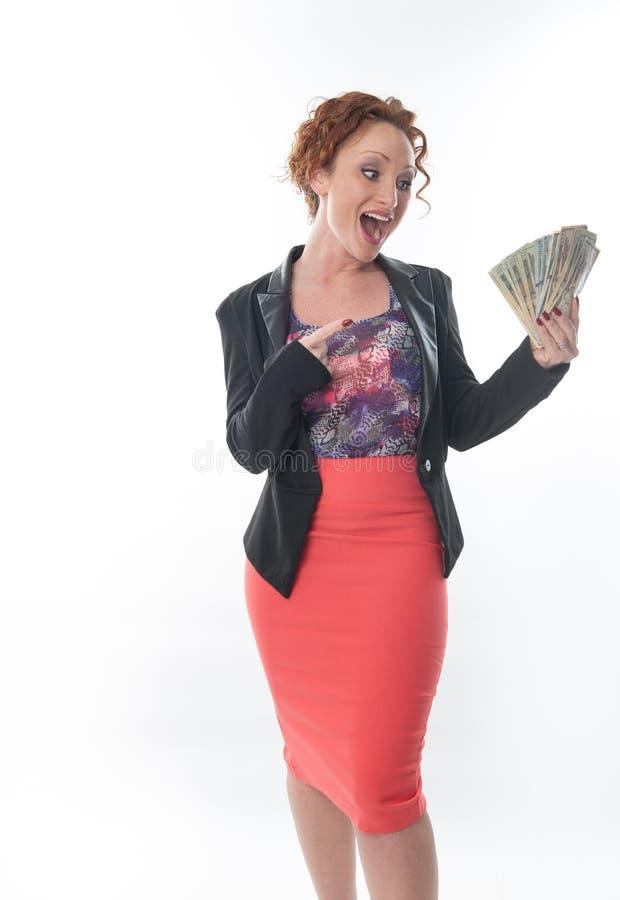 Mulher de negócio que guardara o dinheiro fotos de stock