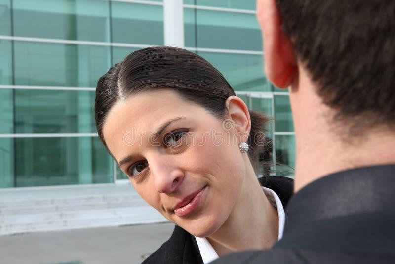 Mulher de negócio que olha o colega passado imagem de stock royalty free