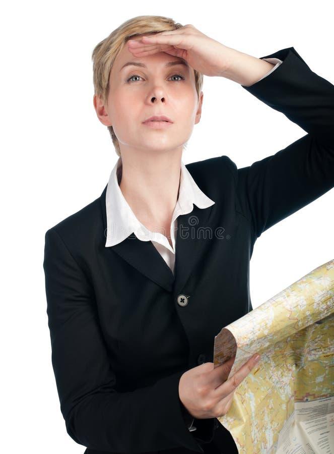Mulher de negócio que olha para a frente com mapa à disposicão imagens de stock