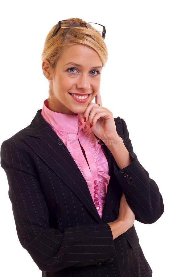 Mulher de negócio que pensa e que sorri fotos de stock