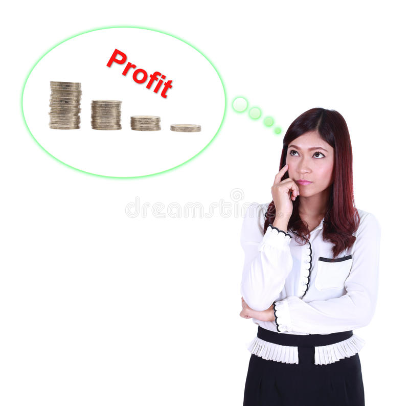 Mulher de negócio que pensa sobre o lucro e o gráfico da moeda fotografia de stock royalty free