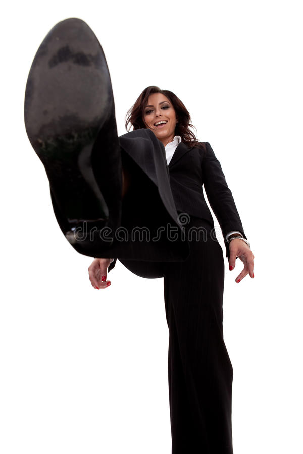 Mulher de negócio que pisa em algo foto de stock