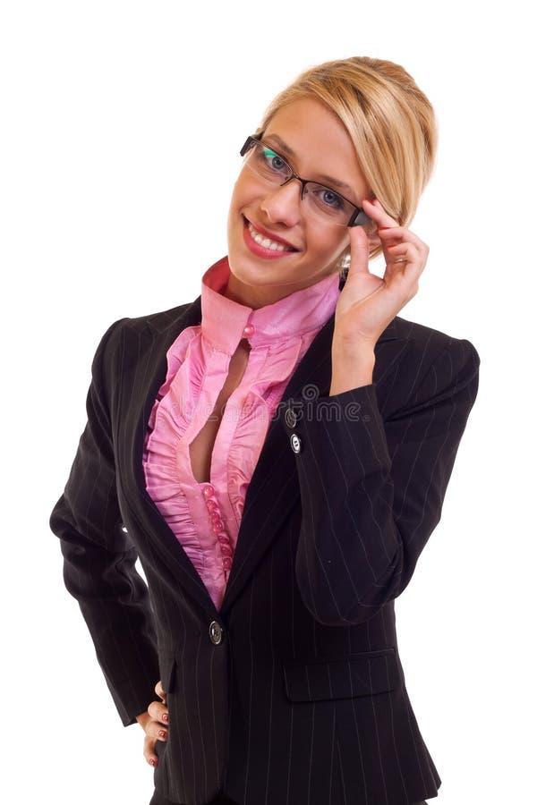 Mulher de negócio que prende seus vidros foto de stock royalty free