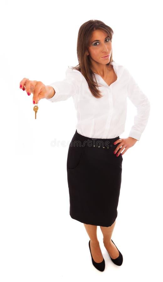 Mulher de negócio que prende uma chave fotografia de stock