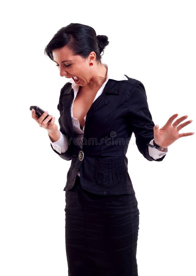 Mulher de negócio que shouting a um telefone imagens de stock royalty free