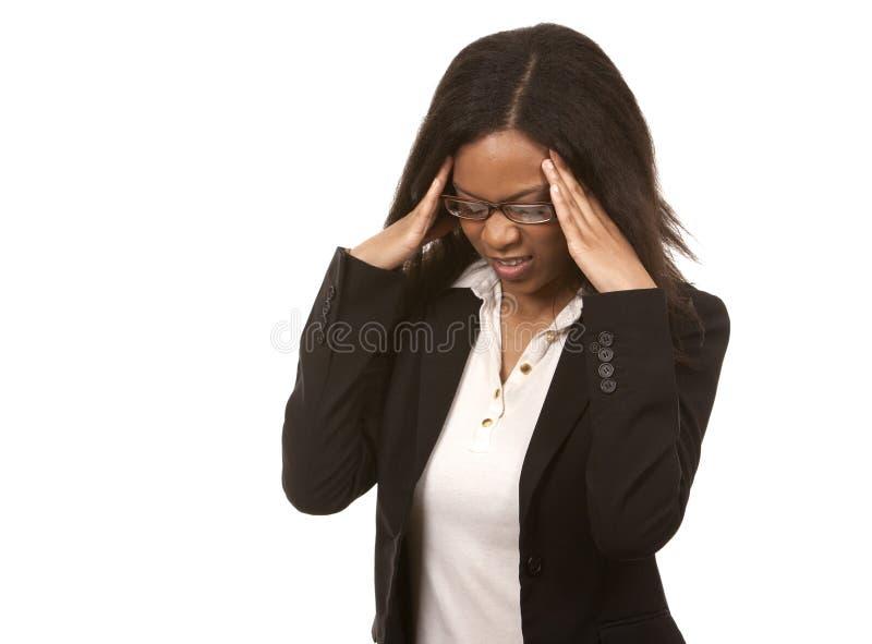 Mulher de negócio que tem uma dor de cabeça fotografia de stock royalty free
