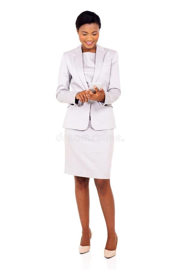 Mulher de negócio que texting fotos de stock