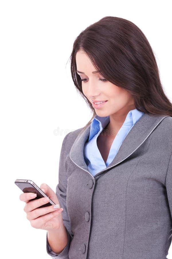 Mulher de negócio que texting de seu telemóvel fotografia de stock