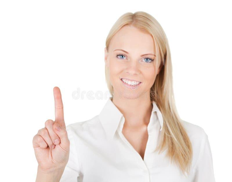 Mulher de negócio que toca na tela com seu dedo foto de stock
