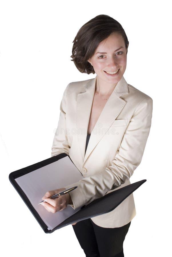 Mulher de negócio que toma notas fotografia de stock