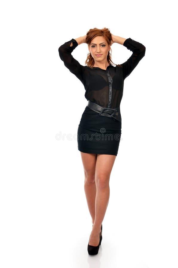 Mulher de negócio segura na pose completa do comprimento foto de stock