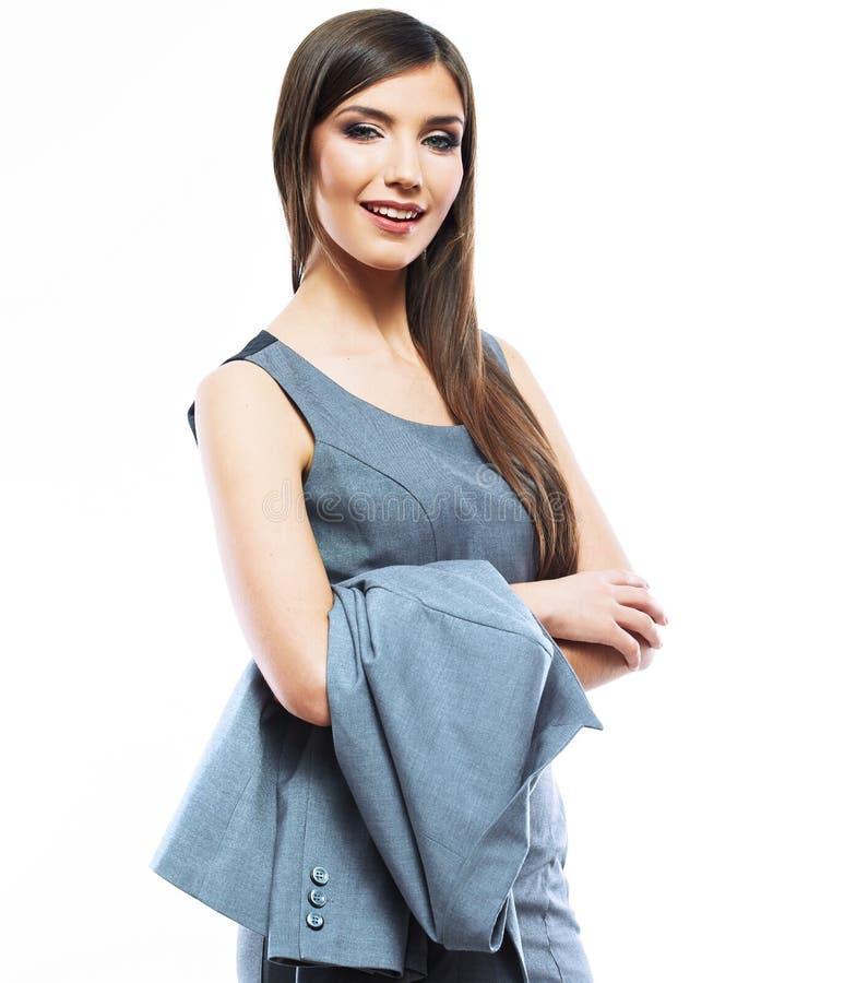 Mulher de negócio de sorriso bonita que está contra o fundo branco imagens de stock