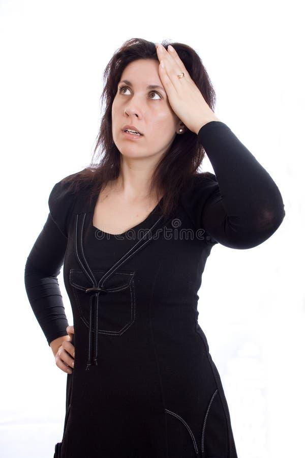 A mulher de negócio tem uma dor de cabeça foto de stock